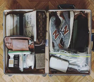 What good things should be in the perfect suitcase of a traveler?